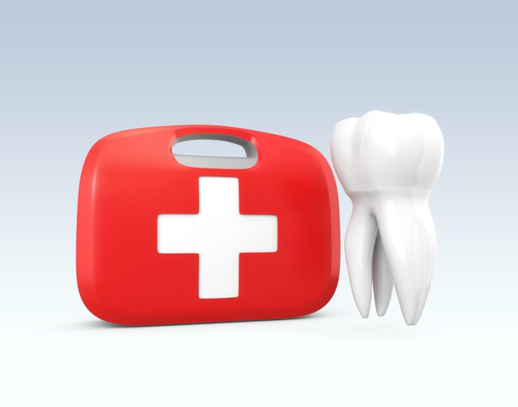 red first-aid kit next to a white tooth