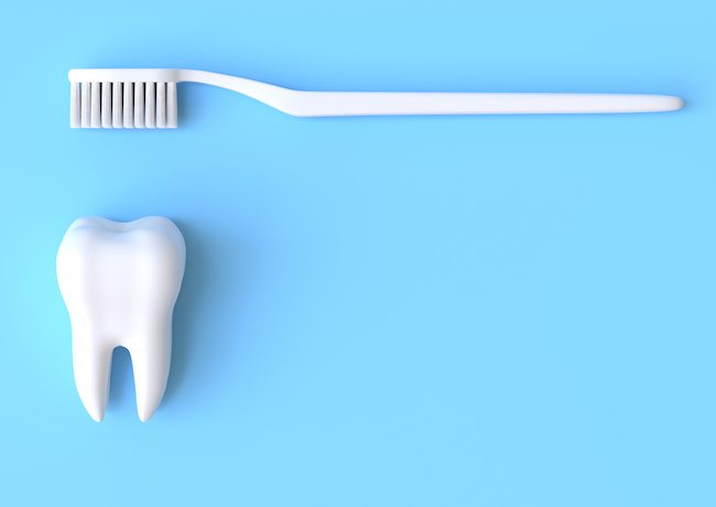 A white toothbrush and a tooth on a blue background